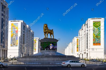 The statue of the Alabai, the Central Asian shepherd dog is seen in Ashgabat, Turkmenistan, . Turkmenistan's autocratic leader has established a national holiday to honor the local dog breed, media reports said Tuesday. President Gurbanguly Berdymukhamedov ordered the holiday praising the Alabai, the Central Asian shepherd dog, to be celebrated on the last Sunday of April when the ex-Soviet nation also marks the day of the local horse breed, according to the daily Neutral Turkmenistan