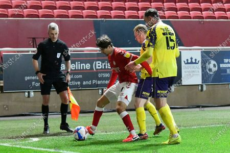 Adam Nagy (4) of Bristol City battles for possession with Lewis O'Brien (8) of Huddersfield Town and Richard Keogh (15) of Huddersfield Town during the EFL Sky Bet Championship match between Bristol City and Huddersfield Town at Ashton Gate, Bristol