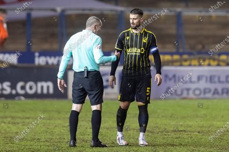 Bristol Rovers defender Max Ehmer (5)  gets a lecture from Match Refereee James Oldham during the EFL Sky Bet League 1 match between Peterborough United and Bristol Rovers at London Road, Peterborough
