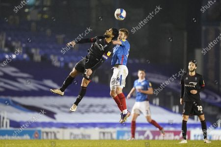 Michael Jacobs of Portsmouth jumps the head the during the EFL Sky Bet League 1 match between Portsmouth and Lincoln City at Fratton Park, Portsmouth