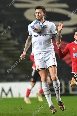 Stock Image of Milton Keynes Dons midfielder Ben Gladwin (7) controls during the EFL Sky Bet League 1 match between Milton Keynes Dons and Charlton Athletic at stadium:mk, Milton Keynes