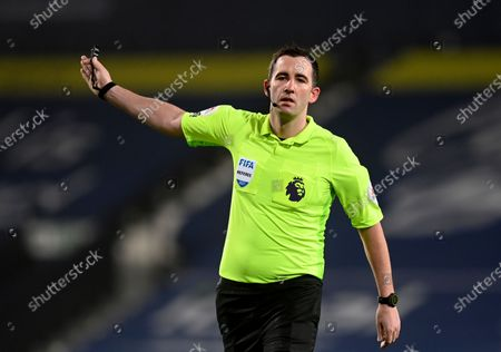 Referee Chris Kavanagh gestures during the English Premier League soccer match between West Bromwich Albion and Manchester City at the Hawthorns stadium in West Bromwich, England