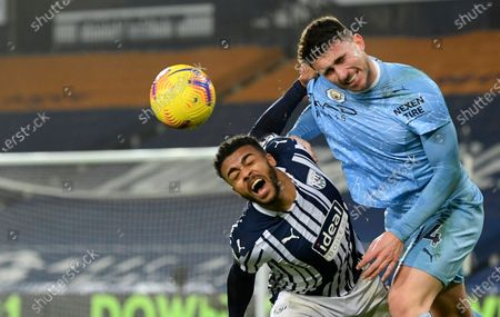 Manchester City's Aymeric Laporte, right, duels for the ball with West Bromwich Albion's Hal Robson-Kanu during the English Premier League soccer match between West Bromwich Albion and Manchester City at the Hawthorns stadium in West Bromwich, England