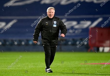 Stock Picture of West Bromwich Albion assistant manager Sammy Lee walks during warm up before the English Premier League soccer match between West Bromwich Albion and Manchester City at the Hawthorns stadium in West Bromwich, England