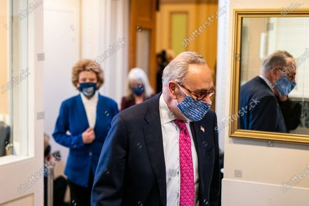 Senate Majority Leader Charles E. Schumer (D-N.Y.) and Sen. Debbie Stabenow (D-M.I.) arrive at a press conference on Capitol Hill, Tuesday, Jan. 26, 2021 in Washington, DC. (Kent Nishimura / Los Angeles Times)