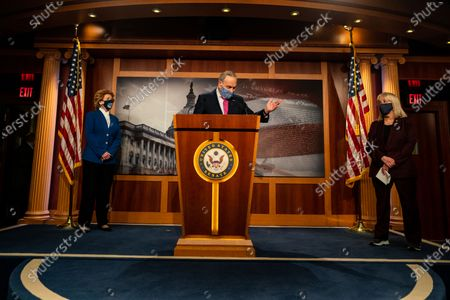 Flanked by Sen. Debbie Stabenow (D-MI) and Sen. Patty Murray (D-WA), Senate Majority Leader Charles E. Schumer (D-NY), center, speaks at a press conference on Capitol Hill on Tuesday, Jan. 26, 2021 in Washington, DC. (Kent Nishimura / Los Angeles Times)