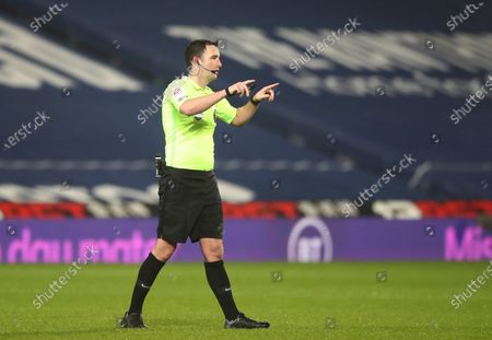 Referee Chris Kavanagh reacts during the English Premier League soccer match between West Bromwich Albion and Manchester City in West Bromwich, Britain, 26 January 2021.