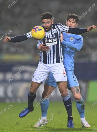 West Bromwich Albion's Hal Robson-Kanu (L) in action with Manchester City's John Stones (R) during the English Premier League soccer match between West Bromwich Albion and Manchester City in West Bromwich, Britain, 26 January 2021.