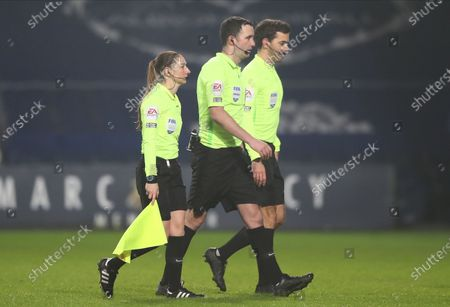 Referee Chris Kavanagh (C), accompanied by his assistants Adam Nunn (R) and Sian Massey-Ellis (R), leaves the pitch after the English Premier League soccer match between West Bromwich Albion and Manchester City in West Bromwich, Britain, 26 January 2021.