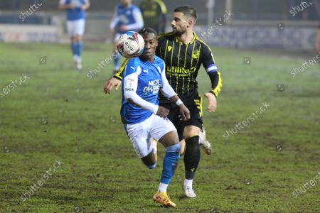 Siriki Dembele of Peterborough United gets away from Max Ehmer of Bristol Rovers