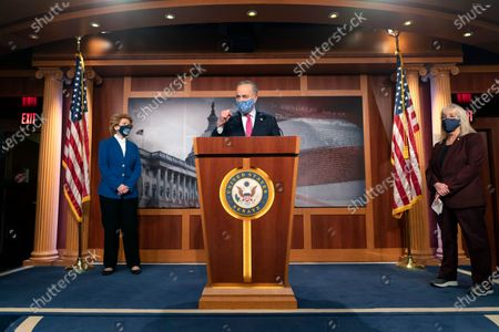 Senate Majority Leader Chuck Schumer of N.Y., center, speaks during a news conference with Sen. Debbie Stabenow, D-Mich., left, and Sen. Patty Murray, D-Wash., on Capitol Hill in Washington