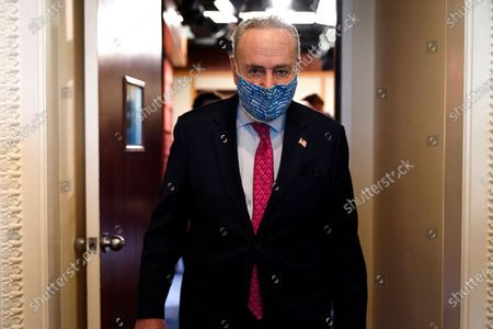 Senate Majority Leader Chuck Schumer of N.Y., leaves a news conference, on Capitol Hill in Washington