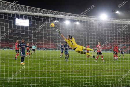 Southampton's goalkeeper Alex McCarthy fails to stop the ball as Arsenal's Nicolas Pepe scores his team's first goal during an English Premier League soccer match between Southampton and Arsenal at the St Mary's stadium in Southampton, England