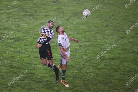 Stock Image of Adil Rami of Boavista in action with Andraz Sporar of Sporting during the portuguese First League (Liga NOS) match between Boavista and Sporting Lisbon at Estadio do Bessa, in Porto