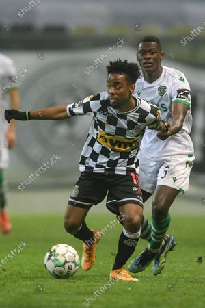 Boavista's player English midfielder Angel Gomes (L) vies for the ball with Sporting's player Portuguese defender Nuno Mendes during the Portuguese First League soccer match between Boavista and Sporting held at Bessa Sec XXI stadium in Porto, Portugal, 26 January 2021.