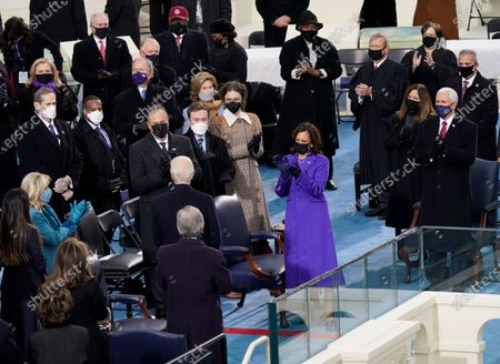 Vice President-elect Kamala Harris applauds with husband Doug Emhoff and her stepchildren Cole and Ella Emhoff as President-elect Joe Biden arrives with his wife Jill Biden for the 59th Presidential Inauguration at the U.S. Capitol in Washington, . Also seen are former President George W. Bush and his wife Laura Bush, former Secretary of State Hillary Clinton, Rep. Steve Scalise, R-La., former Vice President Dan Quayle, Rep. Jim Clyburn, D-S.C., Vice President Mike Pence and his wife Karen Pence, Chief Justice John Roberts Associate Justice Elena Kagan