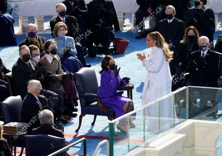 Vice President Kamala Harris looks to Jennifer Lopez during the 59th Presidential Inauguration at the U.S. Capitol in Washington, . Doug Emhoff, Former Vice President Mike Pence and his wife Karen Pence, President-elect Joe Biden, Cole Emhoff, Ella Emhoff, former President George W. Bush, and Laura Bush, Chief Justice John Roberts, and former Vice President Dan Quayle are also seen