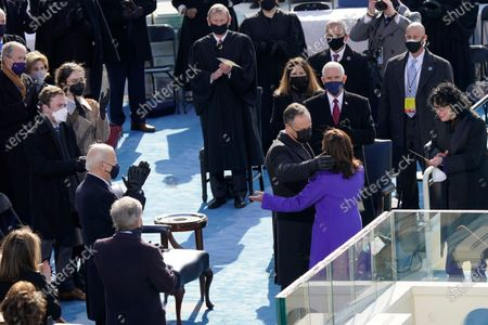 Vice President Kamala Harris hugs her husband Doug Emhoff after being sworn in as Vice President by Supreme Court Justice Sonia Sotomayor during the 59th Presidential Inauguration at the U.S. Capitol in Washington, . Former Vice President Mike Pence and his wife Karen Pence, President-elect Joe Biden, Cole Emhoff, Ella Emhoff, former President George W. Bush, Laura Bush, and Chief Justice John Roberts are also seen