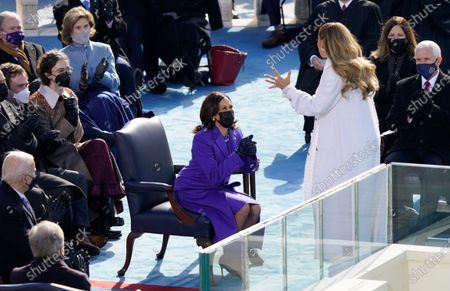 Vice President Kamala Harris looks to Jennifer Lopez during the 59th Presidential Inauguration at the U.S. Capitol in Washington, . Former Vice President Mike Pence and his wife Karen Pence, President-elect Joe Biden, Cole Emhoff, Ella Emhoff, former President George W. Bush, and Laura Bush, are also seen