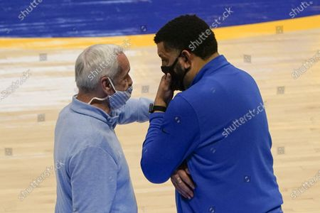Pittsburgh head coach Jeff Capel, right, and North Carolina head coach Roy Williams greet each other near mid-court as time runs down during the second half of an NCAA college basketball game, in Pittsburgh