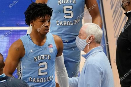 North Carolina head coach Roy Williams, right, greets Caleb Love (2) as he comes off the court against Pittsburgh during the first half of an NCAA college basketball game, in Pittsburgh