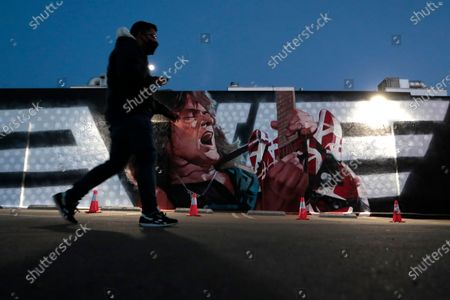 """Los Angeles, CA, Tuesday, January 26, 2021 - A mural honoring the late guitarist Eddie Van Halen, titled """"Long Live The King,"""" is unveiled at Guitar Center Hollywood on what would have been the musician's 66th birthday"""