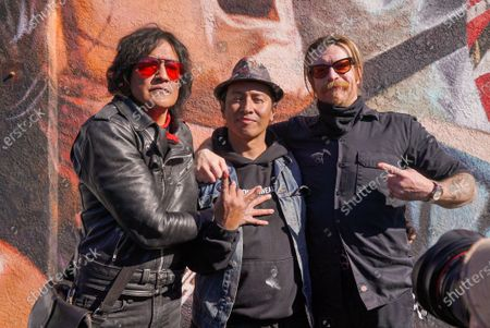 Stock Picture of Marq Torien of Bullet Boys and Artist Robert Vargas. Fans remember Edward Van Halen at the unveiling of a Memorial Mural by artist Robert Vagas at Guitar Center in W. Hollywood, CA on what would have been Van Halen's 66th birthday