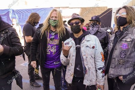 Artist Robert Vargas and guitarist Doug Aldrich of Whitesnake. Fans remember Edward Van Halen at the unveiling of a Memorial Mural by artist Robert Vagas at Guitar Center in W. Hollywood, CA on what would have been Van Halen's 66th birthday