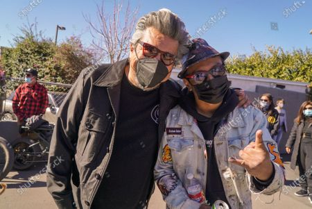 Comedian and Actor George Lopez and Artist Robert Vargas. Fans remember Edward Van Halen at the unveiling of a Memorial Mural by artist Robert Vagas at Guitar Center in W. Hollywood, CA on what would have been Van Halen's 66th birthday