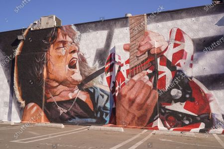 Fans remember Edward Van Halen at the unveiling of a Memorial Mural by artist Robert Vagas at Guitar Center in W. Hollywood, CA on what would have been Van Halen's 66th birthday
