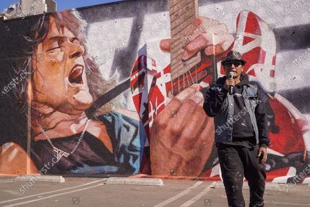 Artist Robert Vargas. Fans remember Edward Van Halen at the unveiling of a Memorial Mural by artist Robert Vagas at Guitar Center in W. Hollywood, CA on what would have been Van Halen's 66th birthday