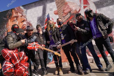 Artist Robert Vargas and various rockers including Taime Downe of Faster Pussycat, Gilby Calrg of Guns N Roses, Doug Aldrich of Whitesnake and Marq Torien of Bullet Boys. Fans remember Edward Van Halen at the unveiling of a Memorial Mural by artist Robert Vagas at Guitar Center in W. Hollywood, CA on what would have been Van Halen's 66th birthday