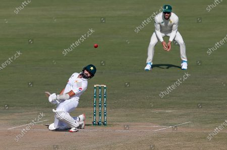 Pakistan's batsman Azhar Ali, front, avoids a ball while South Africa's Faf du Plessis watches during the second day of the first cricket test match between Pakistan and South Africa at the National Stadium, in Karachi, Pakistan