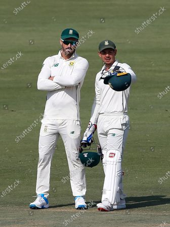 South Africa's Quinton de Kock, right, discusses a point with Faf du Plessis during the second day of the first cricket test match between Pakistan and South Africa at the National Stadium, in Karachi, Pakistan