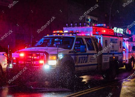 Police officer shot while chasing armed man, New York