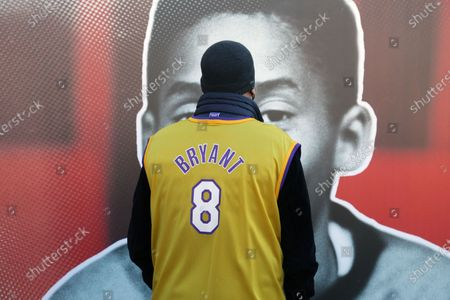 Inauguration of a square and a stone named after Kobe Bryant and his daughter Gianna on the occasion of the first anniversary of their death. Kobe Bryant lived in Italy in his childhood years when his father Jo played in some Italian basketball teams including Pallacanestro Reggiana. In the photo, a Kobe Bryant fan looks at the photographic exhibition dedicated to the Reggio period by Kobe Bryant made near the sports hall