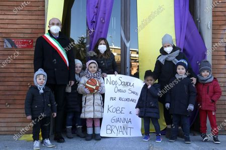 Inauguration of a square and a stone named after Kobe Bryant and his daughter Gianna on the occasion of the first anniversary of their death. Kobe Bryant lived in Italy in his childhood years when his father Jo played in some Italian basketball teams including Pallacanestro Reggiana. in the photo the mayor Luca Vecchi with the children of the Otello Sarzi kindergarten