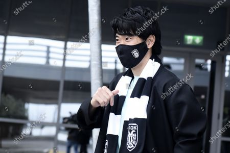 Japanese soccer player Shinji Kagawa gestures, upon his arrival at the airport in the northern city of Thessaloniki, Greece,. Former Manchester United and Borussia Dortmund midfielder Shinji Kagawa has moved to PAOK based in the northern Greek city of Thessaloniki, the soccer club announced on Wednesday, Jan. 27, 2021