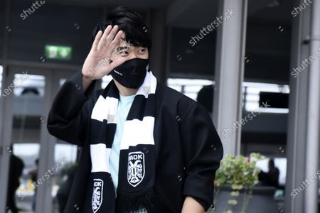 Japanese soccer player Shinji Kagawa waves upon his arrival at the airport in Thessaloniki, Greece,. Former Manchester United and Borussia Dortmund midfielder Shinji Kagawa has moved to PAOK based in the northern Greek city of Thessaloniki, the soccer club announced on Wednesday, Jan. 27, 2021