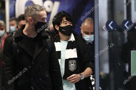 Stock Picture of Japanese soccer player Shinji Kagawa, center, arrives at the airport in Thessaloniki, Greece,. Former Manchester United and Borussia Dortmund midfielder Shinji Kagawa has moved to PAOK based in the northern Greek city of Thessaloniki, the soccer club announced on Wednesday, Jan. 27, 2021