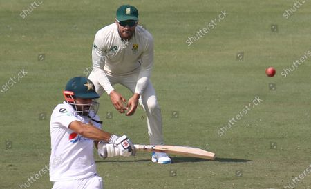 Pakistani batsman Muhammad Rizwan plays a shot as South Africas Faf du Plessis looks on during the second day of first cricket test match between Pakistan and South Africa in Karachi, Pakistan, 27 January 2021. The South African cricket squad arrived in Pakistan for their first tour consisting of two Test and three T20 matches after a 14-year break.