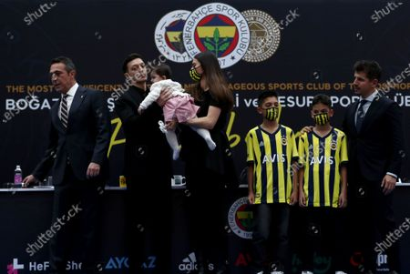 Fenerbahce's new transfer Mesut Oezil (2-L) poses with his wife Amine Gulse and their daughter Eda after the signing ceremony in Istanbul, Turkey, 27 January 2021. Oezil signed a contract until summer 2024.