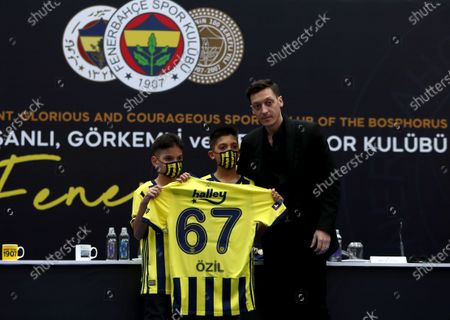Fenerbahce's new transfer Mesut Oezil (R) poses with two young fans after the signing ceremony in Istanbul, Turkey, 27 January 2021. Oezil signed a contract until summer 2024.