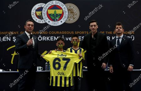 Fenerbahce's new transfer Mesut Oezil (R-2) poses with Fenerbahce President Ali Koc (L) and sporting director Emre Belozoglu (R)  during the signing ceremony in Istanbul, Turkey, 27 January 2021. Oezil signed a contract until summer 2024.