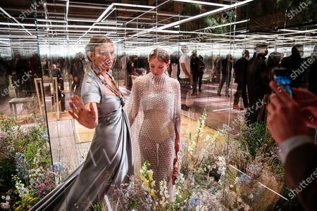 Model Kate Moss, left, and her daughter Lila Grace Moss wear creations for Fendi's Spring-Summer 2021 Haute Couture fashion collection presented Wednesday, Jan.27, 2021 in Paris