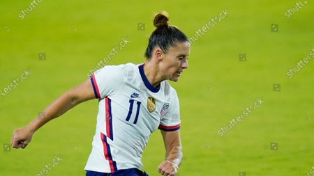 United States defender Ali Krieger (11) moves the ball against Colombia during the second half of an international friendly soccer match, in Orlando, Fla