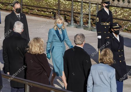 First lady Jill Biden walks past former President Bill Clinton and Hillary Clinton and former President George W. Bush and Laura Bush as President Joe Biden and Vice President Kamala Harris arrive to lay a wreath at the Tomb of the Unknown Soldier at Arlington National Cemetery in Arlington, Va