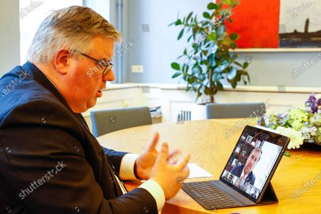 King Willem Alexander speaks online with mayors in response to the disturbances in Dutch cities, Nijmegen