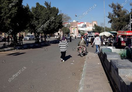 Yemenis walk through a street where a two-year-long 2011-uprising protest camp was set up outside Sana'a University, ahead of the tenth anniversary of the uprising, in Sana'a, Yemen, 20 January 2021 (issued 27 January 2021). Yemen on 27 January 2021 marks the 10th anniversary of the 2011 Arab Spring uprising that toppled the then-president Ali Abdullah Saleh.
