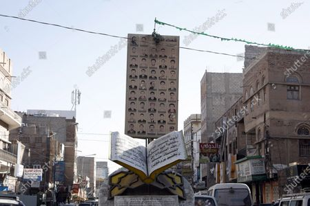 Stock Photo of Vehicles drive past the memorial to dozens of slain protesters of the 2011 Arab Spring uprising at a street where a two-year-long 2011-uprising protest camp was set up, ahead of the tenth anniversary of the uprising, in Sana'a, Yemen, 20 January 2021 (issued 27 January 2021). Yemen on 27 January 2021 marks the 10th anniversary of the 2011 Arab Spring uprising that toppled the then-president Ali Abdullah Saleh.